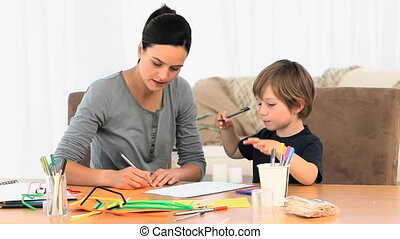 Boy and mom drawing together