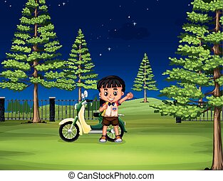 Boy and motorcycle in the park