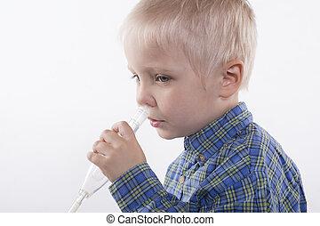 boy and nasal aspirator - young boy using nasal aspirator,...