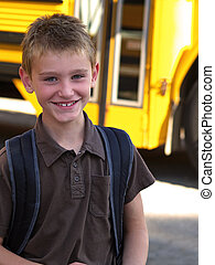 boy and school bus - a smiling school boy with a yellow...