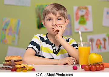Boy and tough choice - Little boy and tough choice for food...