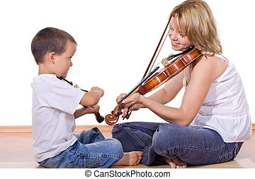 Boy and woman practicing the violin - Little boy and woman...