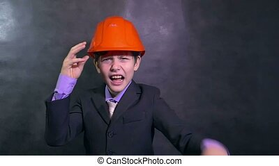 boy angry architect teenage builder in helmet swears yells dissatisfied error slow motion