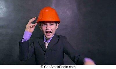 boy angry architect teenage builder in helmet swears yells...