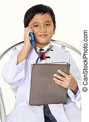 Boy as a doctor holding Tablet