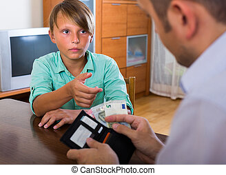 Boy asking father for money