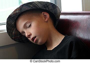 Boy Asleep In Booth