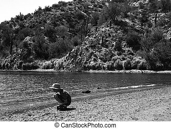 Young boy at the edge of a desert lake - 36 megapixel image shot on film - as scanned edge cropping and spotting only. Film grain apparent at this large size