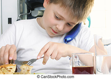 Boy at breakfast with phone