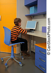 boy at computer in children\'s room