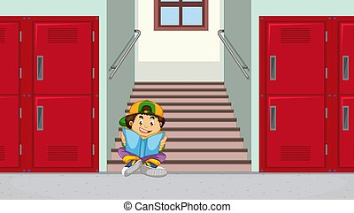 Boy at school stairs reading a book