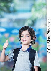 Boy at school with thumbs up