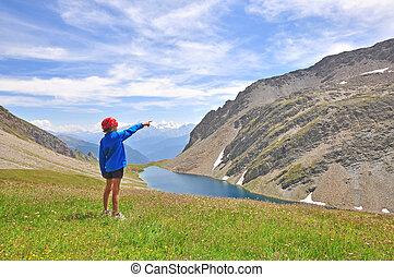 Boy at the mountain lake