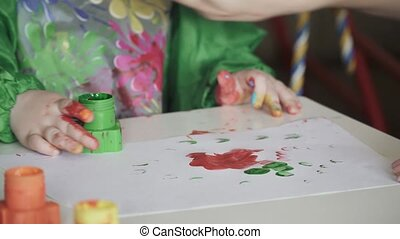 Boy at the table draws