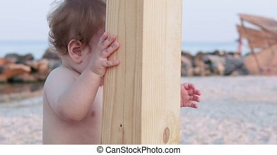 Boy at the wooden post