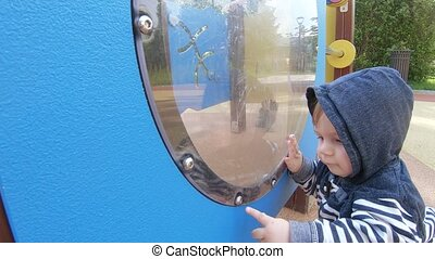 Boy baby in the porthole