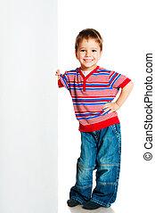 boy beside a white blank