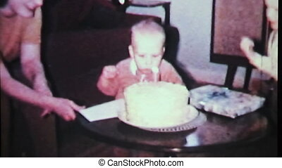 Boy Blows Out Birthday Candle-1965