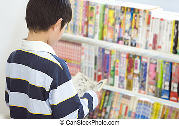 boy browsing at convenience store