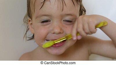 Boy brushing his teeth - Pretty little baby boy brushing his...