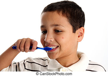 Young boy with brown hair brushing teeth on white background