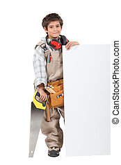Boy builder with a board left blank for your message
