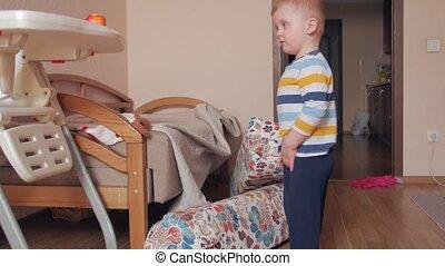Boy builds pillows on the floor home interior