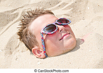 Boy buried in sand