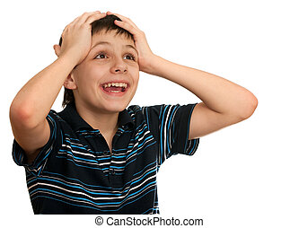 A shocked kid is holding his hands at the head; isolated on the white background