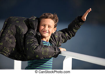 boy catching wind