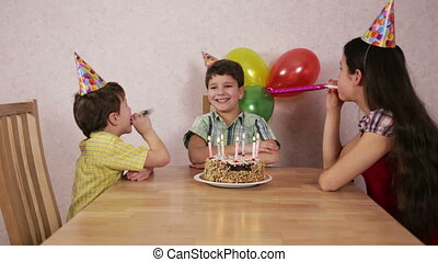 Boy celebrate his birthday at home with family