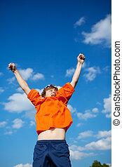 boy celebrating victory