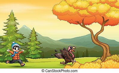 Boy chasing a turkey in the park
