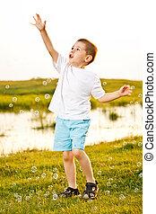 Boy Chasing Bubbles