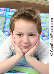 Boy Child Bedroom - Close up of adorable five year old boy...