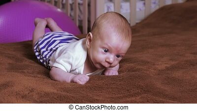 Boy child learn to crawl - On the carpet baby boy learning ...