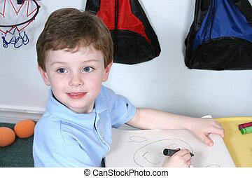 Boy Child Preschool - Handsome and happy little boy sitting...