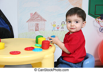 Boy Child Preschool - Two year old boy playing with colorful...