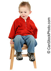 Small 1 year old boy sitting on a wooden step stool. Shot over white.