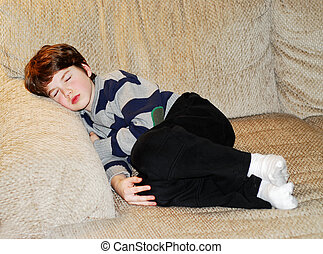 Boy child sleeping - Cute little boy sleeping on a couch