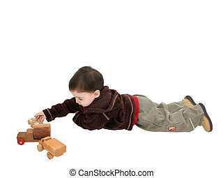 Boy Child with Wooden Toy Cars - Small boy playing with old...