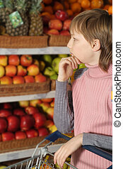 Boy chooses products in the store