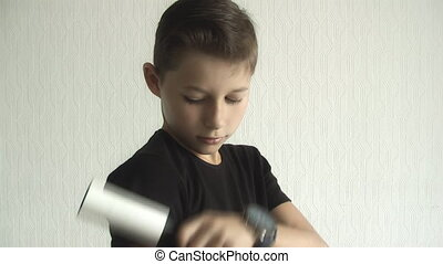 boy cleans clothes from dirt