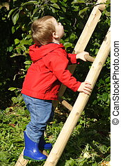 Boy Climbing Ladder - A toddler boy wearing a red jacket and...