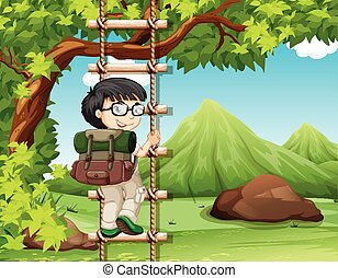 Boy climbing up the wooden ladder in park