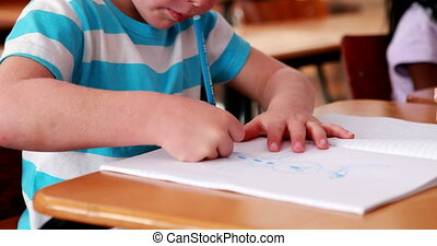 Boy colouring in the classroom - Little boy colouring in the...