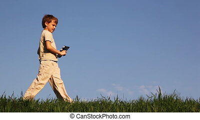 Boy comes on grass, click clapperboard