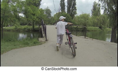 Boy conducts a bicycle