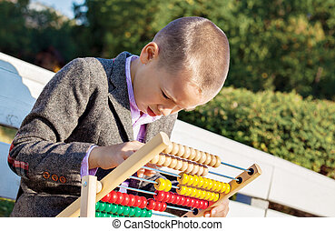 boy counting abacus