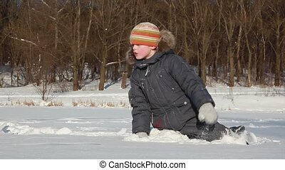 Boy creep by snow and left deep imprint on it